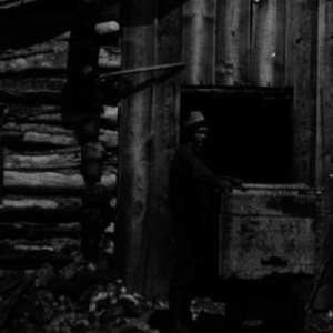 Click this thumbnail for a full view of Tunnel House, Dream Mine,  Johnson Creek. Shown is S. J. Houser, owner. Abajo Mountains, San Juan County, Utah.  1915.