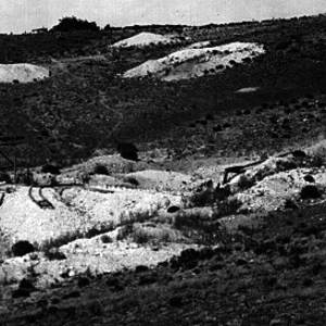 Click this thumbnail for a full view of Looking north towards Colorado Turquoise Mining  Company mines. 13 miles south 60 degrees east of La Jara.  Shafts near office and to right on hill. Incline to right of frame work, about center of picture. Conejos County, Colorado. 1910.