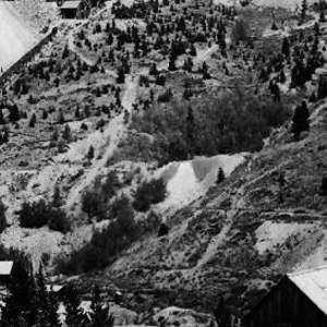Click this thumbnail for a full view of Jessie Mine, nearer view looking northwest from the south side of Gold Run. Hydraulic workings in the foreground.   Breckenridge District. Summit County,  Colorado. 1909. Published as 29-A in U.S. Geological Survey Professional paper 75, 1911.
