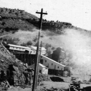 Click this thumbnail for a full view of Looking south from same point as No. 103. The American Fuel Company of Utah's buildings, loading tipple and washing jigs.  Grand County, Utah. 1914.
