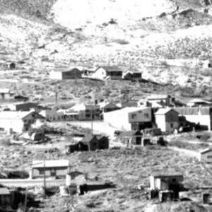 Click this thumbnail for a full view of General view from north of Randsburg towards the Yellow Aster Mine. Glory hole lies beyond large dumps; pale patches are remnants of old mill tailings.