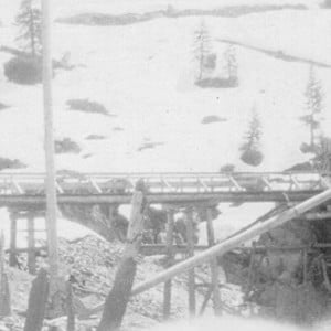Click this thumbnail for a full view of A miner using a monitor (giant) at a hydraulic mine in the snow.