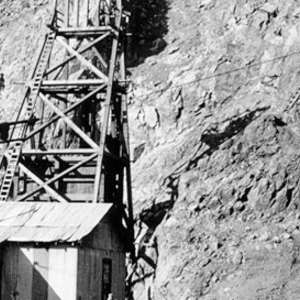 Click this thumbnail for a full view of Buildings, headframe, and glory hole at Yellow Aster Mine, Randsburg