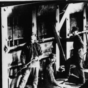 """Click this thumbnail for a full view of View of stamps, plates, and miners at Yellow Aster Mine Mill.  50 stamps were """"dropping"""" at this mill in 1912."""